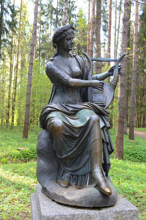 suburb: ST.PETERSBURG, RUSSIA - MAY 13, 2012: Statue of a woman in Pavlovsk park, suburb of St. Petersburg.