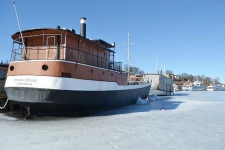 pleasure craft: LAPPEENRANTA, FINLAND - MARCH 25, 2015: Lappeenranta harbor on the Saimaa lake at winter, Finland.