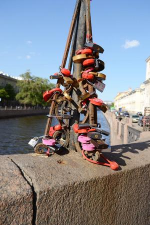 infatuation: ST.PETERSBURG, RUSSIA - 25 MAY, 2012: Locks of Love on Bridge of Kisses.