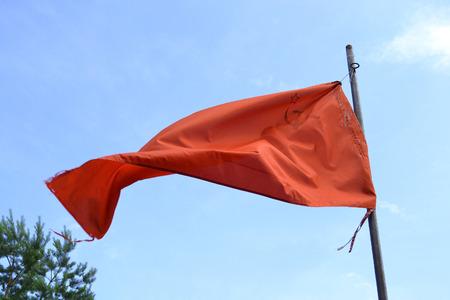 soviet flag: Red soviet flag on blue sky background.