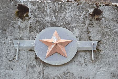 socialism: Red Star on a concrete wall of an old bunker in Sestroretsk, Russia.
