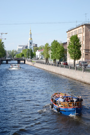 pleasure ship: ST.PETERSBURG, RUSSIA - 25 MAY, 2012: Pleasure boats on the canal in the center of St. Petersburg.
