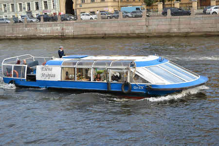pleasure ship: ST.PETERSBURG, RUSSIA - AUGUST 22, 2012: Pleasure river boat on canal in center of St. Petersburg.