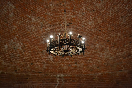 sigulda: Interior of an old castle with a vintage chandelier in Sigulda, Latvia.