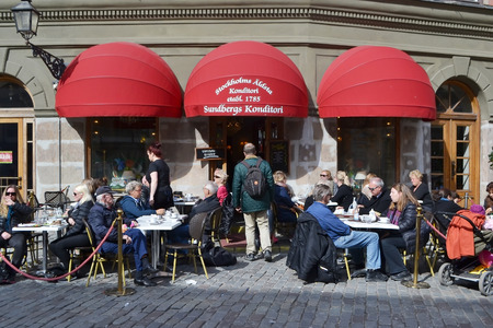 gamla stan: STOCKHOLM, SWEDEN - APRIL 19, 2015: Cafe on the street of The Old Town (Gamla Stan) in Stockholm. Editorial