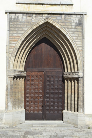 gothic build: Old door of St. Nicholas Church in Tallinn, Estonia. Stock Photo