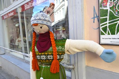 linked hands: TALLINN, ESTONIA - APRIL 20, 2015: Funny hand made dolls on street in Tallinn.