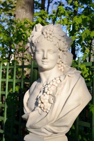 bacchus: Statue of Allegory of Autumn (Bacchus) in Summer Garden, St.Petersburg, Russia. Dionysus - in Greek mythology, the youngest of the Olympians, the god. Stock Photo