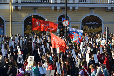 comrades: ST.PETERSBURG, RUSSIA: - MAY 9, 2015: Communist demonstration on the Nevsky Prospect on the day of the victory in World War II. Editorial