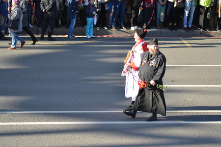 cossack parade: ST.PETERSBURG, RUSSIA: - MAY 9, 2015: Russian Cossack and Orthodox priest on Victory parade. The celebration of 70 anniversary of Victory in the Great Patriotic War.