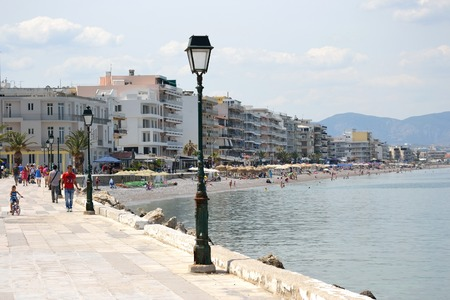well known: LOUTRAKI, GREECE - 1 JUNE, 2015: Embankment in Loutraki.. Loutraki - resort city, which is well known in Greece because of its mineral springs.