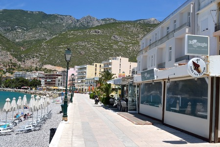 well known: LOUTRAKI, GREECE - 2 JUNE, 2015: Embankment in Loutraki.. Loutraki - resort city, which is well known in Greece because of its mineral springs.