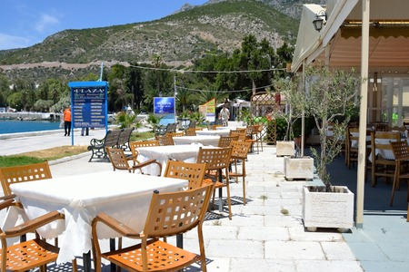 is well known: LOUTRAKI, GREECE - 2 JUNE, 2015: Street cafe on embankment in Loutraki.. Loutraki - resort city, which is well known in Greece because of its mineral springs. Editorial