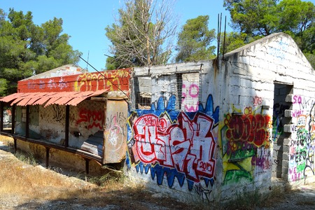 well known: LOUTRAKI, GREECE - 30 MAY, 2015: Old abandoned building painted graffiti in Loutraki. Loutraki - resort city, which is well known in Greece because of its mineral springs. Editorial
