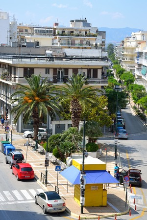 well known: LOUTRAKI, GREECE - 31 MAY, 2015: Street in Loutraki. Loutraki - resort city, which is well known in Greece because of its mineral springs.