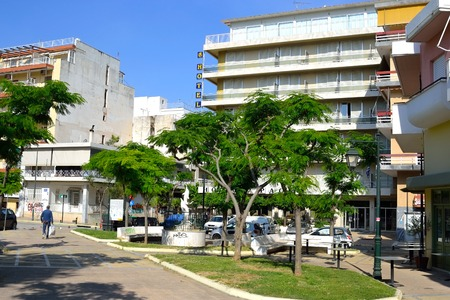 well known: LOUTRAKI, GREECE - 1 JUNE, 2015: Street in Loutraki. Loutraki - resort city, which is well known in Greece because of its mineral springs.