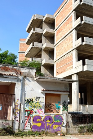 is well known: LOUTRAKI, GREECE - 1 JUNE, 2015: Old abandoned building painted graffiti in Loutraki. Loutraki - resort city, which is well known in Greece because of its mineral springs.