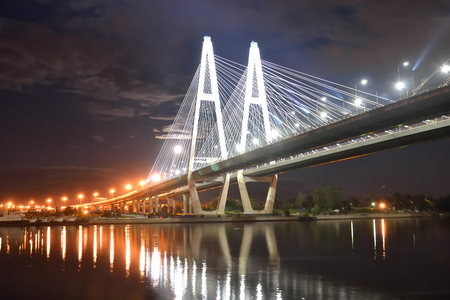 piter: Cable-stayed bridge with illumination across the Neva River in St.Petersburg, Russia.