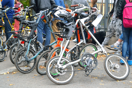 parked bikes: ST.PETERSBURG, RUSSIA - SEPTEMBER 19, 2015: Several parked folding bicycles. Cycling on folding bikes Bike Kompakt.