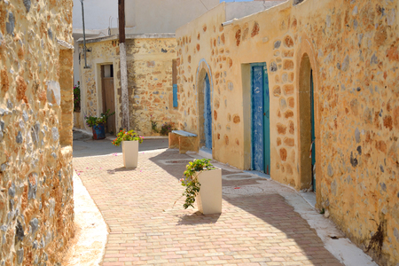 mediterranean house: The narrow street in the old part of Malia, Crete, Greece. Stock Photo