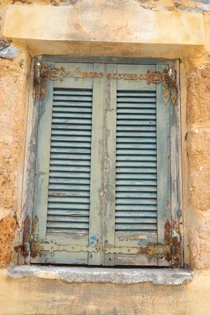 mediterranea: Window of an old apartment building in Malia, Crete, Greece.