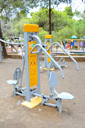 outside machines: LOUTRAKI, GREECE - 28 MAY, 2015: Exercise equipment in the park. Loutraki - resort city, which is well known in Greece because of its mineral springs.