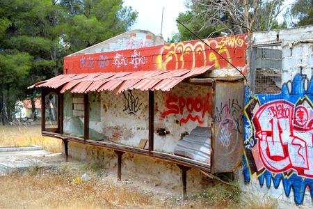 is well known: LOUTRAKI, GREECE - 28 MAY, 2015: Old abandoned building painted graffiti in Loutraki. Loutraki - resort city, which is well known in Greece because of its mineral springs.