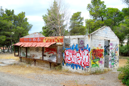 vandalize: LOUTRAKI, GREECE - 28 MAY, 2015: Old abandoned building painted graffiti in Loutraki. Loutraki - resort city, which is well known in Greece because of its mineral springs.