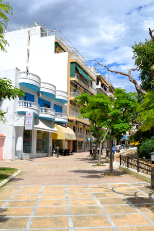 is well known: LOUTRAKI, GREECE - 30 MAY, 2015: Street in Loutraki. Loutraki - resort city, which is well known in Greece because of its mineral springs. Editorial