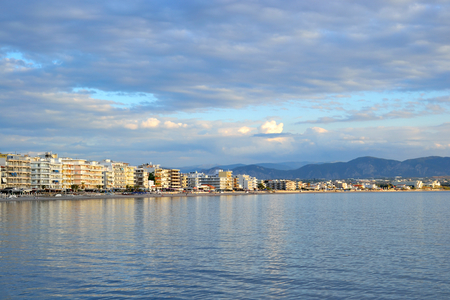 water town: Embankment in Loutraki town at evening, Greece. Stock Photo