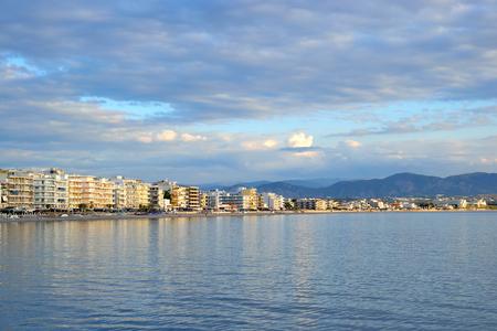 embankment: Embankment in Loutraki town at evening, Greece. Stock Photo