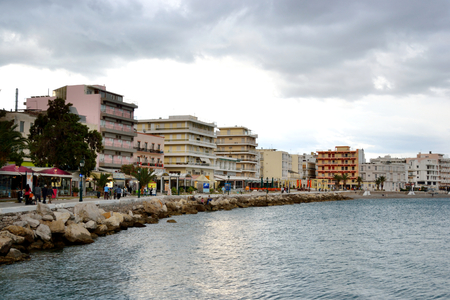 is well known: LOUTRAKI, GREECE - 28 MAY, 2015: Embankment in Loutraki.. Loutraki - resort city, which is well known in Greece because of its mineral springs. Editorial