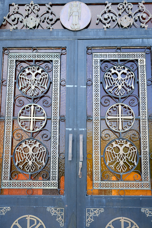 pacification: LOUTRAKI, GREECE - 29 MAY, 2015: Fragment of door of Orthodox Church Ekklisia Agios Ioannis in Loutraki town, Greece. Editorial