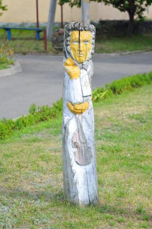 pagan: STOLIN, BELARUS - JULY 27, 2015: Wood pagan sculpture on street of Stolin town. Editorial