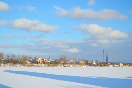outskirts: Coast of the river Neva on the outskirts of St. Petersburg at sunny winter day, Russia. View Novosaratovka village.