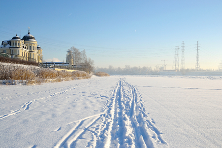 outskirts: Frozen River Neva at sunny winter day, outskirts of St. Petersburg, Russia.
