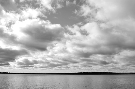 isthmus: Lake at cloud day in Karelian Isthmus, Russia. Black and white. Stock Photo