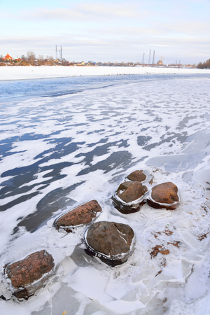 outskirts: View of Neva River on the outskirts of St. Petersburg at sunny winter day, Russia.