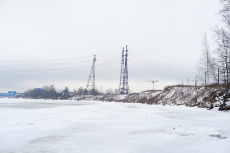outskirts: Coast of the river Neva on the outskirts of St. Petersburg at cloud winter day, Russia. Stock Photo