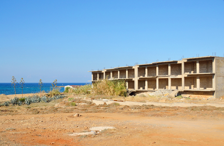 unfinished building: Unfinished building in Loutraki at sunny summer day, Greece. Stock Photo