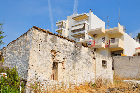 residential home: LOUTRAKI, GREECE - 1 JUNE, 2015: Old home and modern residential building. Loutraki - resort city, which is well known in Greece because of its mineral springs.