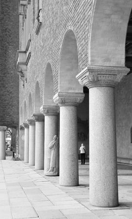 cityhall: Colonnade of Stockholm City Hall in Sweden. Black and white.