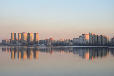 outskirts: View of Neva river and microdistrict Ribatskoe on the outskirts of St. Petersburg at sunset, Russia. Stock Photo