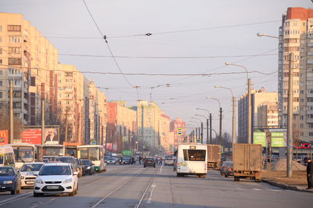 outskirts: ST.PETERSBURG, RUSSIA - MARCH 29, 2016: Shlisselburgsky avenue in microdistrict Ribatskoe on the outskirts of St. Petersburg at sunny spring evening.
