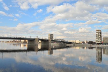 embankment: Volodarsky Bridge in St.Petersburg at cloud spring day, Russia. Stock Photo