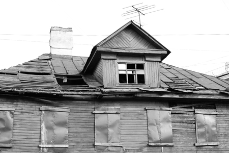 outskirts: Abandoned wooden building in Kolpino town on the outskirts of St. Petersburg, Russia. Black and white.