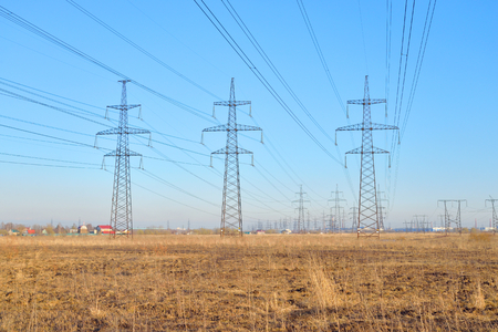 outskirts: Power line in the countryside in the early spring on the outskirts of St. Petersburg, Russia. Stock Photo