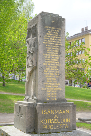 a cudgel: LAPPEENRANTA, FINLAND - MAY 11, 2016: Monument in the park in the center of Lappeenranta with a bas-relief in the form of coat of arms of the city of Lappeenranta.