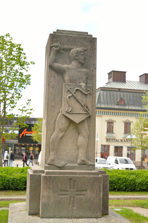 city coat of arms: LAPPEENRANTA, FINLAND - MAY 11, 2016: Monument in the park in the center of Lappeenranta with a bas-relief in the form of coat of arms of the city of Lappeenranta.