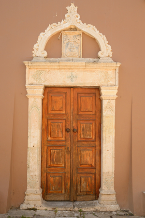 mediterranea: Door of an old building in Hersonissos, Crete, Greece. Stock Photo